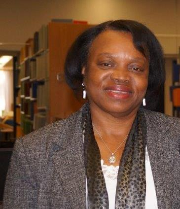 Picture of Mary Jo Fayoyin in the Savannah State University library
